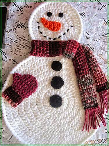Улыбка вязаного крючком снеговика в фото