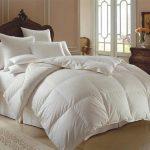 elegant-bedroom-oversized-white-bedspreads-down-comforter-elegant-white-crystal-chandelier-white-goose-down-pillows-brass-table-lamp