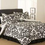 modern-bedroom-black-white-floral-flocking-bedspread-set-queen-black-padded-headboard-queen-light-brown-carpet-under-bed-wooden-tray-bedside-table