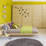 yellow-bedroom-with-fitted-wardrobes-ideal-home-housetohome.co.uk