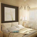 спальня бежевых оттенков с лилией на стене