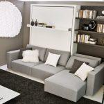 диван-кровать с подушками и встроенными полками