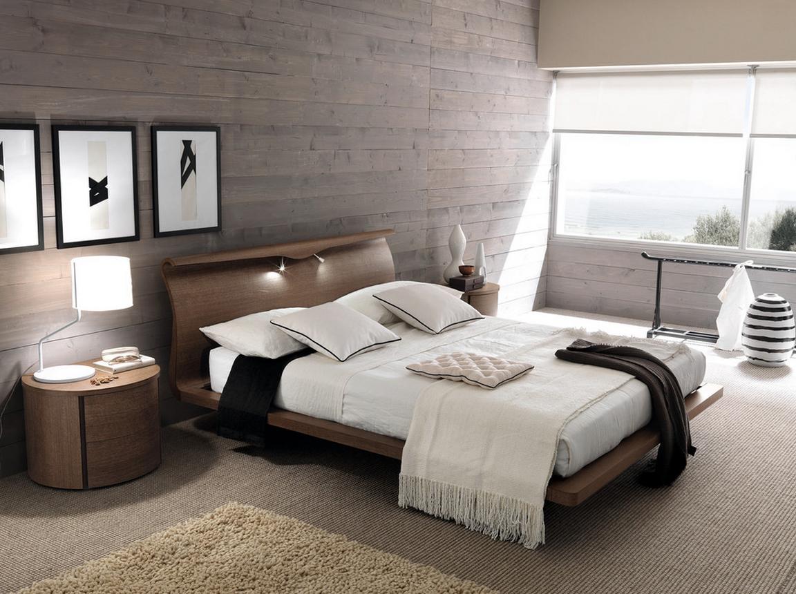 современная спальня в стиле лофт с картинами на стене