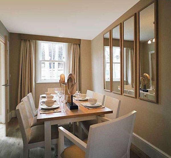 В кухне над обеденным столом зеркало по фен-шуй