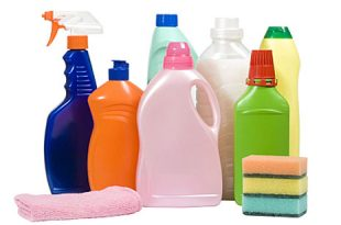 There are plastic bottles of various cleaning supplies
